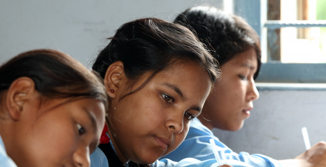 Adolescent girls study in Nepal. Photo: Jim Holmes/AusAID.