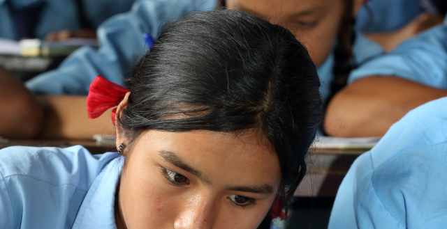 A student studies in grade 8 at Shree Dharmasthali Lower Secondary School, Pokhara, Nepal. Credit: Jim Holmes for AusAID