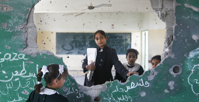 11 year old Manar and her friends at their damaged school in Gaza © Anas al Baba/Oxfam, January 2015