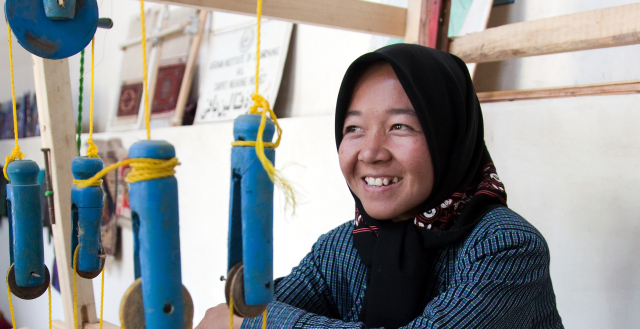 Sughira, works at weaving silk. Credit: World Bank