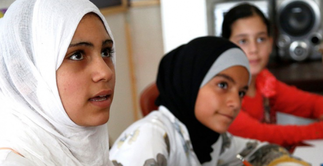 Teenage Syrian girls take part in a discussion about children's rights, at a community centre in Lebanon © Russell Watkins/Department for International Development