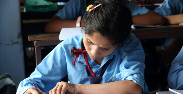 A student studies in grade 8 at Shree Dharmasthali Lower Secondary School, Pokhara, Nepal. Photo: Jim Holmes/AusAID.