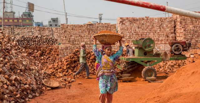 Adolescent girl working at a brick factory in Mohammadpur, Dhaka. Photo: Nathalie Bertrams/GAGE