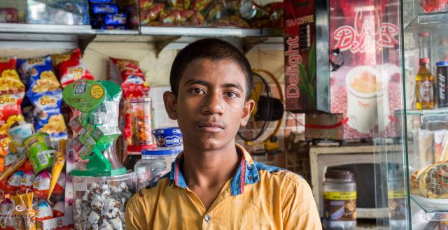 13-year-old boy working in a shop in Chittagong, Bangladesh. Photo: Nathalie Bertrams/GAGE