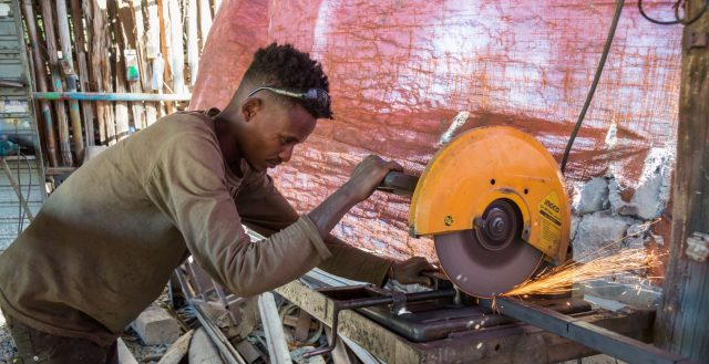 An adolescent boy working as a metal worker in Ethiopia. Photo: Nathalie Bertrams/GAGE 2020
