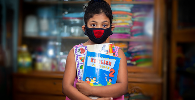 A teenage girl wearing a protective cloth mask against transmissible COVID-19 diseases in Dhaka. Photo: Jahangir Alam Onuchcha/Shutterstock.com